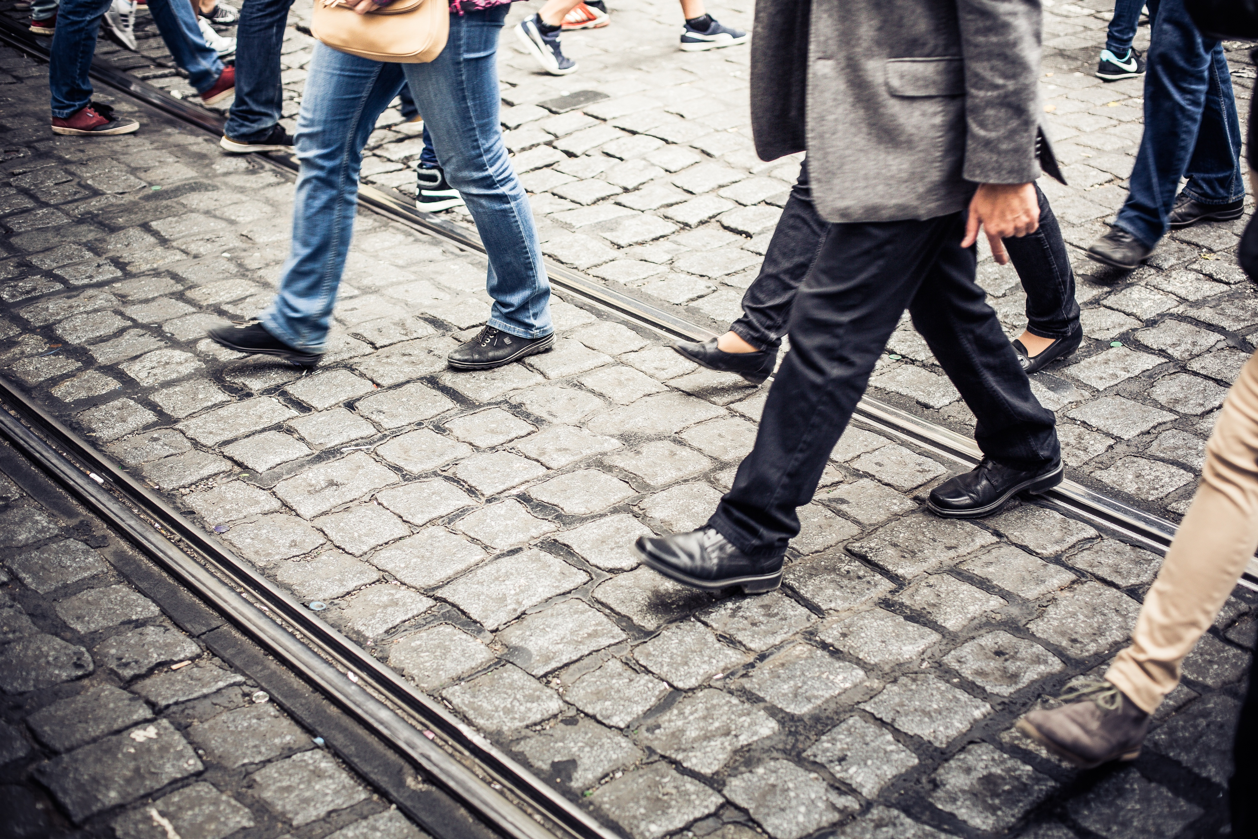 Crowd_of_People_Crossing_an_Old_Prague_Road.jpg